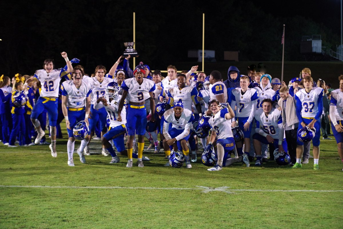 Football team poses with the Dog Bowl after a big win over Berea