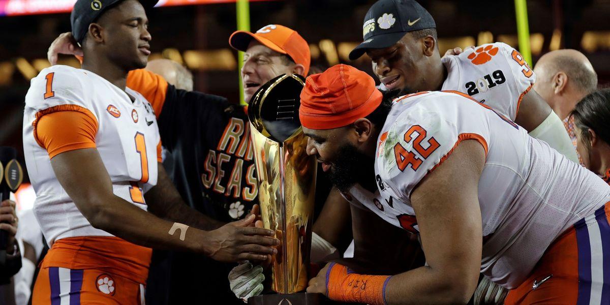 DT Christian Wilkins, DE Clelin Ferrell, and CB Trayvon Mullen, Jr. celebrate with head coach Dabo Swinney.