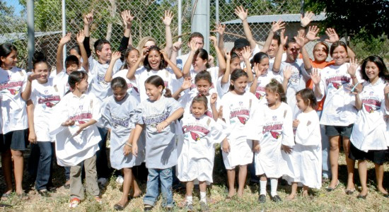 group of children wearing a losing team's merchandise