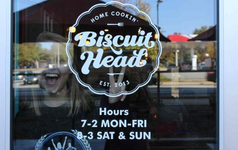 Kendall Silvers poses with the Biscuit Head logo