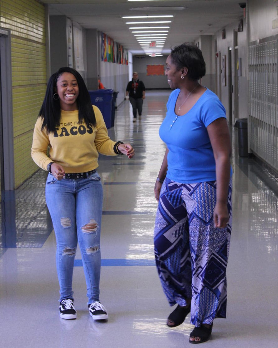 Zoe Brailsford (left) with her mom, Ms. Brailsford (right) laughing at a joke they share