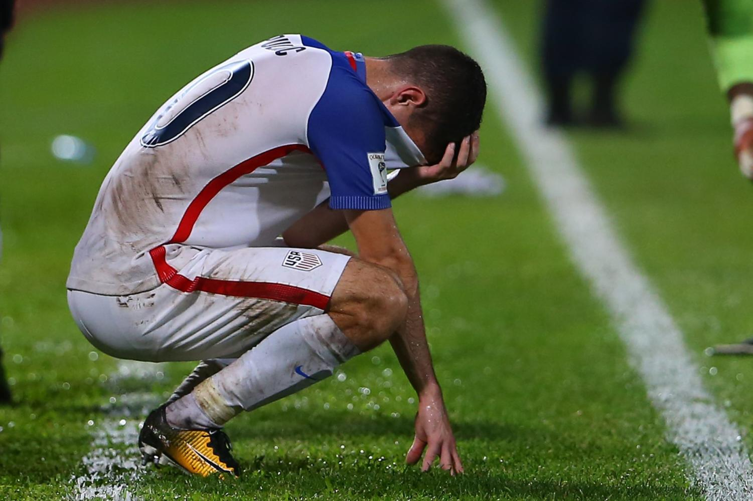 19 year old Christian Pulisic crouching in shame after World Cup aspirations were crushed