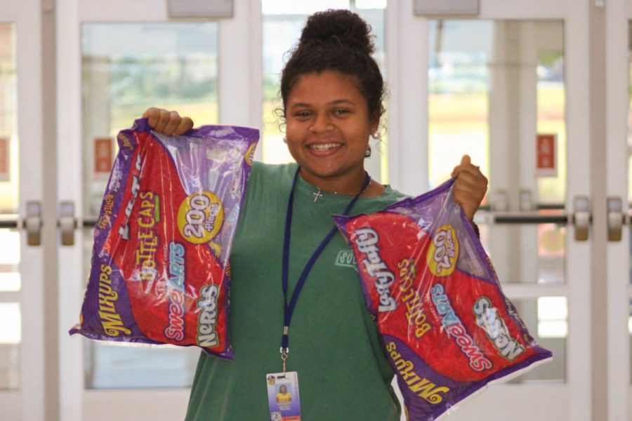 Sophomore+Barrett+Moody+posing+with+candy+bags+to+be+donated