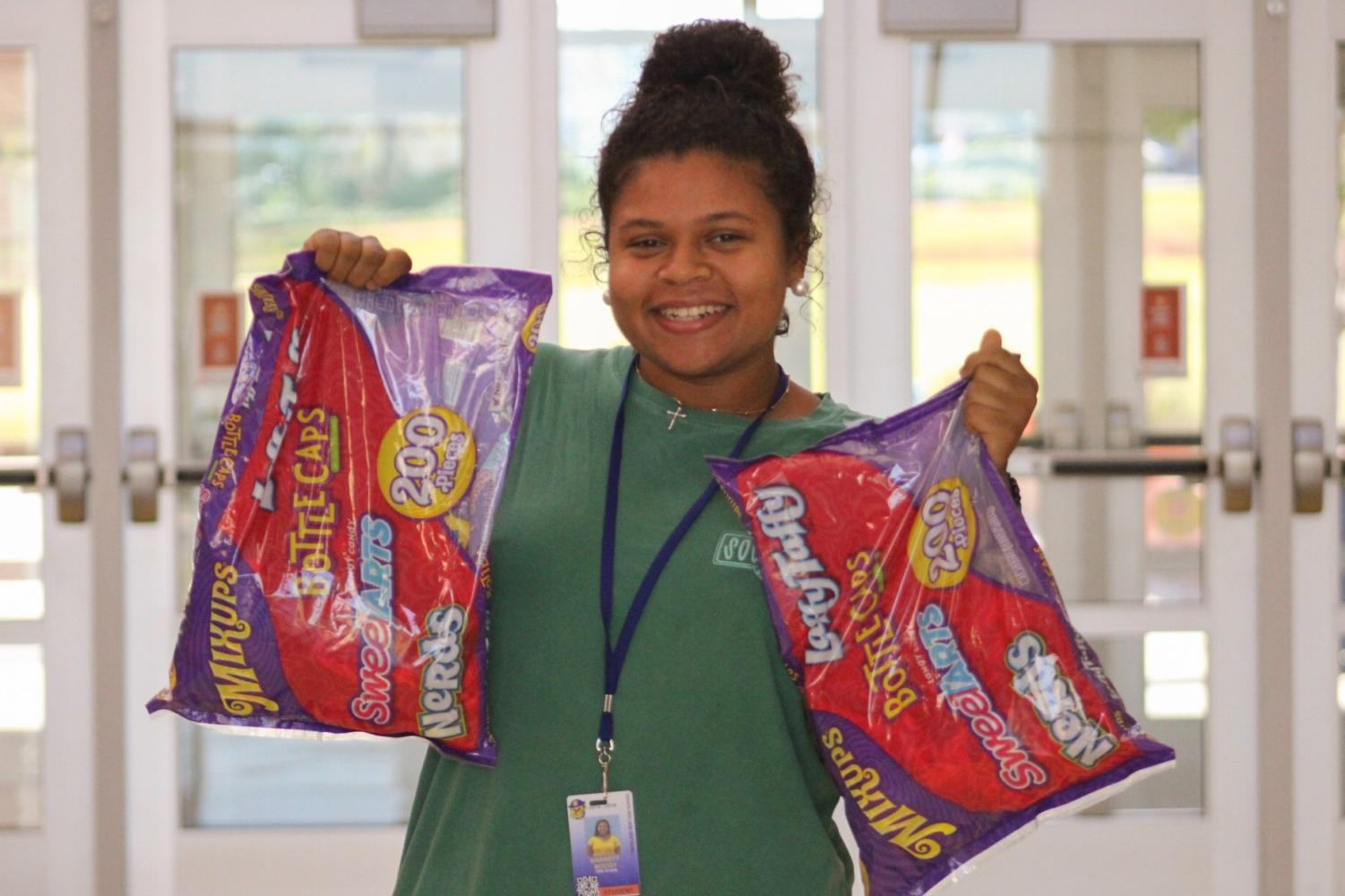 Sophomore Barrett Moody posing with candy bags to be donated